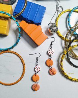 Long orange polka dots earrings